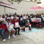 High school students fill gift bags for homeless