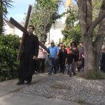 Video: Crowd walks across city with cross on Good Friday