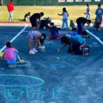 Photos: Youths fill crosswalk with chalk before Movies in the Park