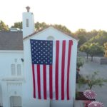 Video: Drone view of giant flag on SBHS admin building for 9/11