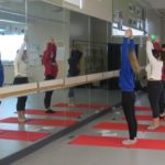 SBHS students teach yoga to staff members