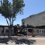 Fire injures four firefighters, damages four businesses